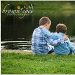 brothers catching frogs at a pond
